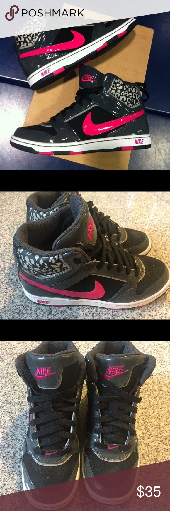 Nike Leopard High Top Sneakers Cheetah Gently used Nike High Too Sneakers.  Black and Pink with silver Cheetah/Leopard print.  Size 7. Nike Shoes Sneakers