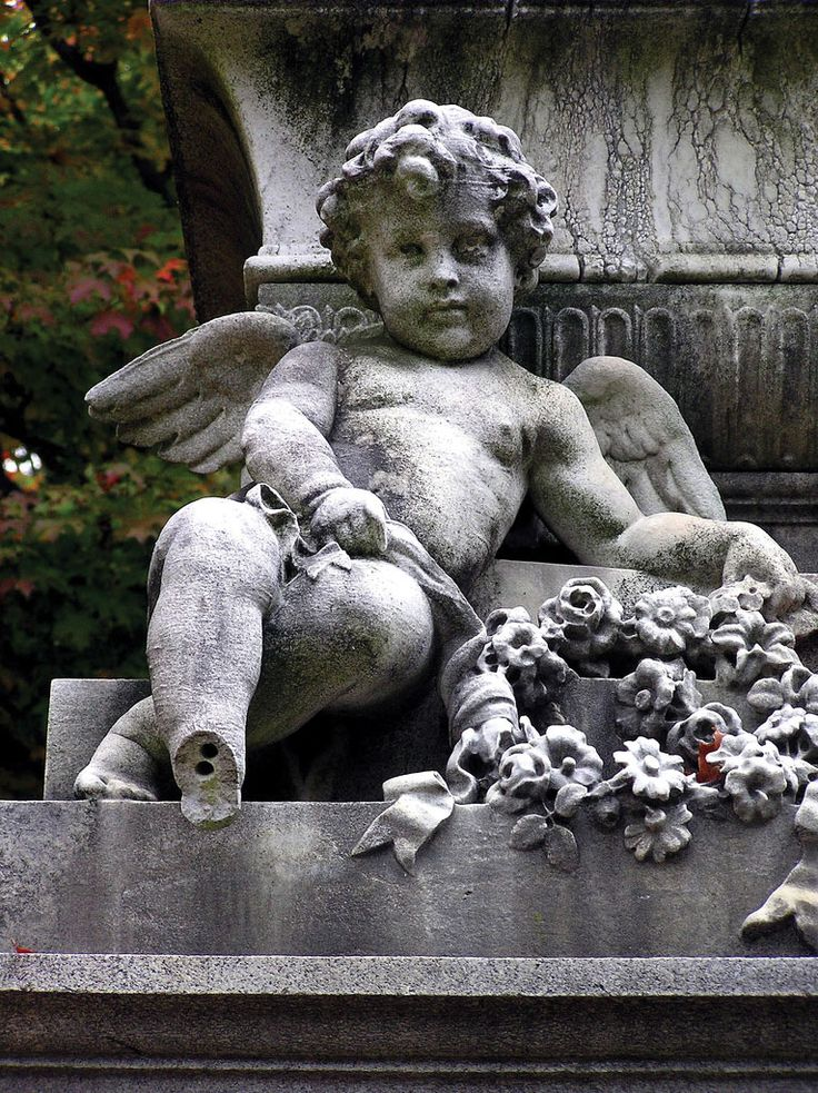 Cherubs and floral sprays are common Victorian-era embellishments on monuments throughout Mount Auburn. They, like angels, symbolized a connection with heaven.  Karen Marlene Larsen