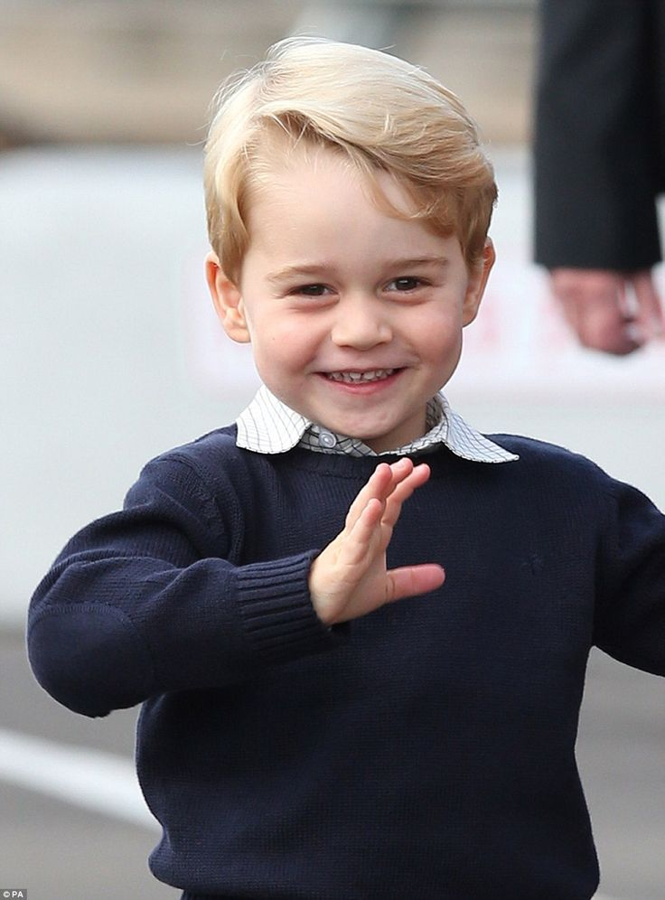 George, three, dressed in his familiar shorts and long socks, couldn't stop smiling and waving at the cheering well-wishers as he got out of the car, holding his father's hand