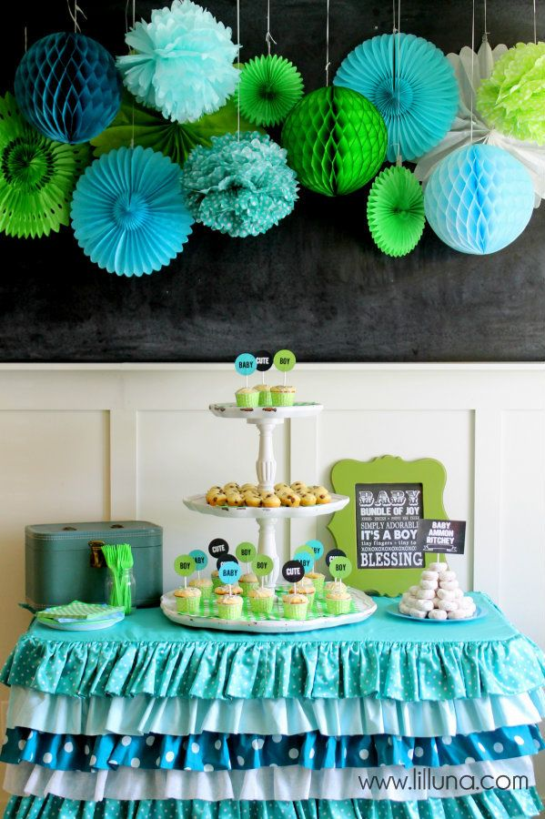 The color combinations for this shower are adorable! Tissue fans and globes make for the perfect backdrop. #babyshower @HUGGIES Baby Shower Planner Baby Shower Planner Baby Shower Planner Baby Shower Planner
