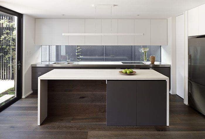 Kitchen - window splashback with undermount rangehood  Mink Grey American Oak floors and also on island bench www.royaloakfloors.com.au