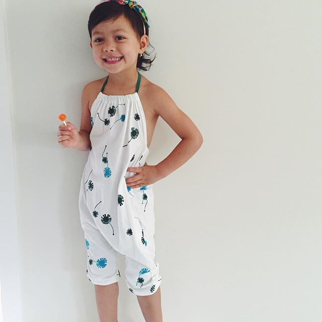 It's all about SUMMER and @eloiseannika looks so fresh and 'summery' in her #dandelionprint #halterneck #jumpsuit the perfect outfit for sticky languid days... And currently #onsale #onlinenow #organiccotton #exclusivelydesigned #ethicallymade #madeinindia #originaldesigns #igkidsfashion