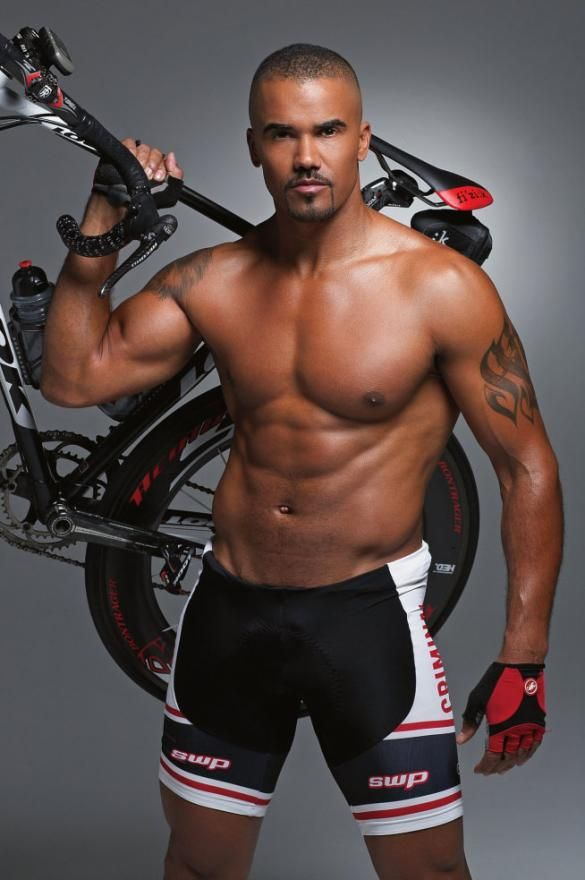 Actor Shemar Moore, shirtless and looking very fit in tight little bike pants that accentuate *every* bulge. Mmmm hmmm.