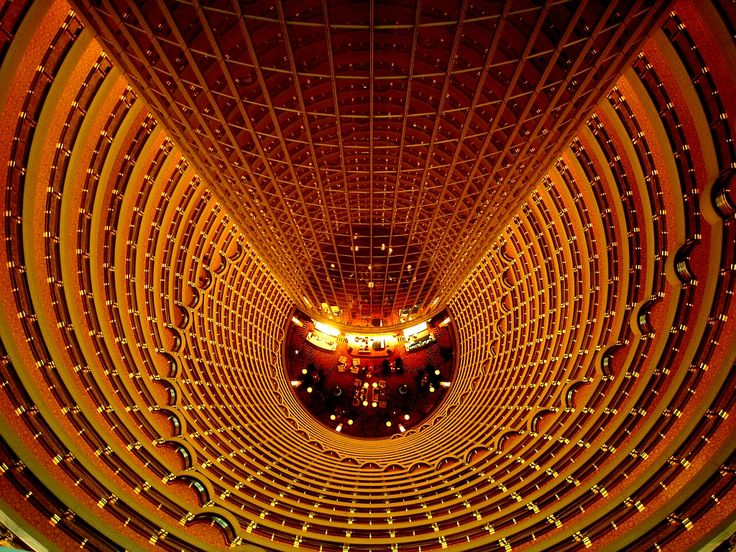 Jinmao Tower: Jinmao Tower is one of the symbolic buildings of the 21st century in Shanghai. It's height, 420.5 m, is next to the Double Tower in Kuala Lumpur in Malaysia and the Sears Building in Chicago, USA.   It is the tallest in the country and the third tallest in the world. It is a high-class, intelligent building serving as offices, business centers and hotel.