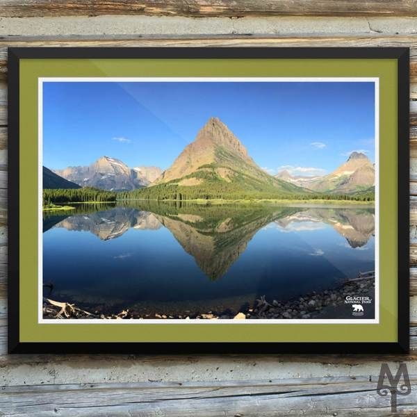 An iconic photograph of an unforgettable sunrise on Swiftcurrent Lake, Glacier National Park, is now a museum-quality poster...only on the Montana Treasures web site. Shop now!