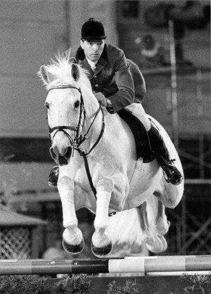 John Whitaker with his white horse fairytale Milton.