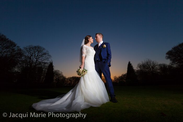 Bride and groom at sunset during their winter wedding at New Place in Hampshire. Photographed by Hampshire wedding photographers Jacqui Marie Photography. VISIT http://jacqui-marie-photography.co.uk for details.