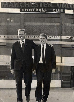 Buying at Old Trafford, Leeds united manager Don Revie (left) with new signing from Manchester United, Johnny Giles