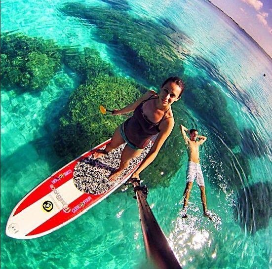 Floating in the crystal clear waters of the Marshall Islands  #sup #paddleboard #standuppaddle
