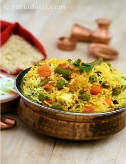 Vegetable biryani is a traditional mughlai main course item loaded with chopped vegetables, spices, saffron and dry fruits. On normal days, you can make it as a one-pot meal. Even as ingredients like capsicum and coriander spread their aroma, whiffs of saffron and other spices rise above all and pamper your senses.