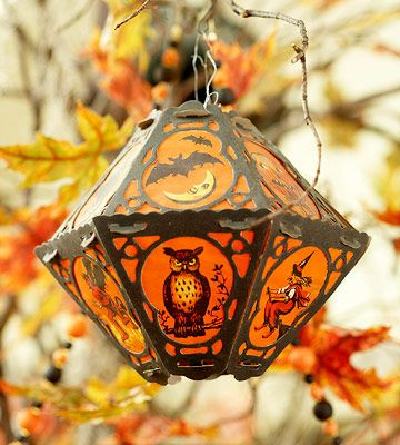 A 1930s Halloween lantern makes a perfect prop for decorating an indoor tree. Or try dangling a collection of classic 1950s cardboard Halloween die cuts from tree branches.