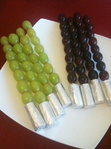Fun, healthy light saber snacks for a Star Wars party. Wrap old wine corks in foil for the handle, then stick it with a skewer of green and red grapes! Might want to dull the pointy skewer end for little ones. Was a big hit!