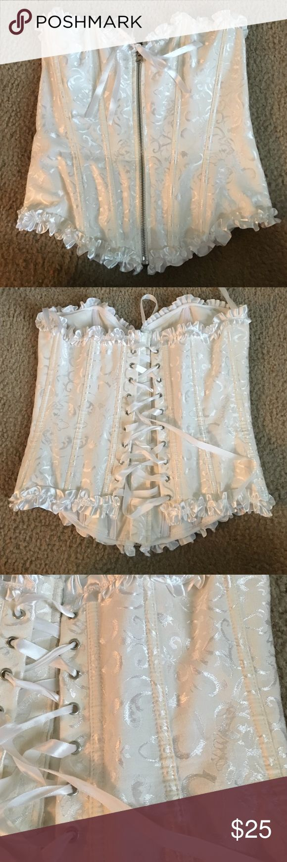 Beautiful bustier Worn once!  Super flattering bustier.  Cute to wear under plaid shirt and cutoff jean shorts for that country look. shirley of hollywood Tops