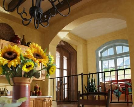 Welcoming archways add to the relaxed feel of a Southwestern house. Doors, windows and walkways feature these charming architectural elements.