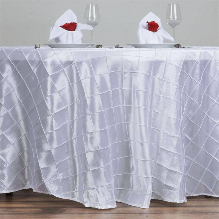 "White Pintuck Tablecloths 120"" Round - Pintuck is actually a fold of fabric that is stitched intricately to hold it in a place, very much like a pleat. These lovely pleats impart a decorative effect to the fabric by fashioning a visual line at a chosen point. They effortlessly bridge vintage and contemporary styles to create a majestic new classic look. If you do not want your celebration to blend in with other weddings, birthdays, and anniversaries, try our premium quality pintuck…"