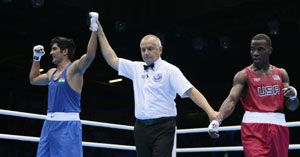 Vijender Singh became India's first boxer at the London Olympics 2012 to  qualify for the quarter-final on Friday. Vijender beat his American  opponent in an extremely tight battle by 16-15.
