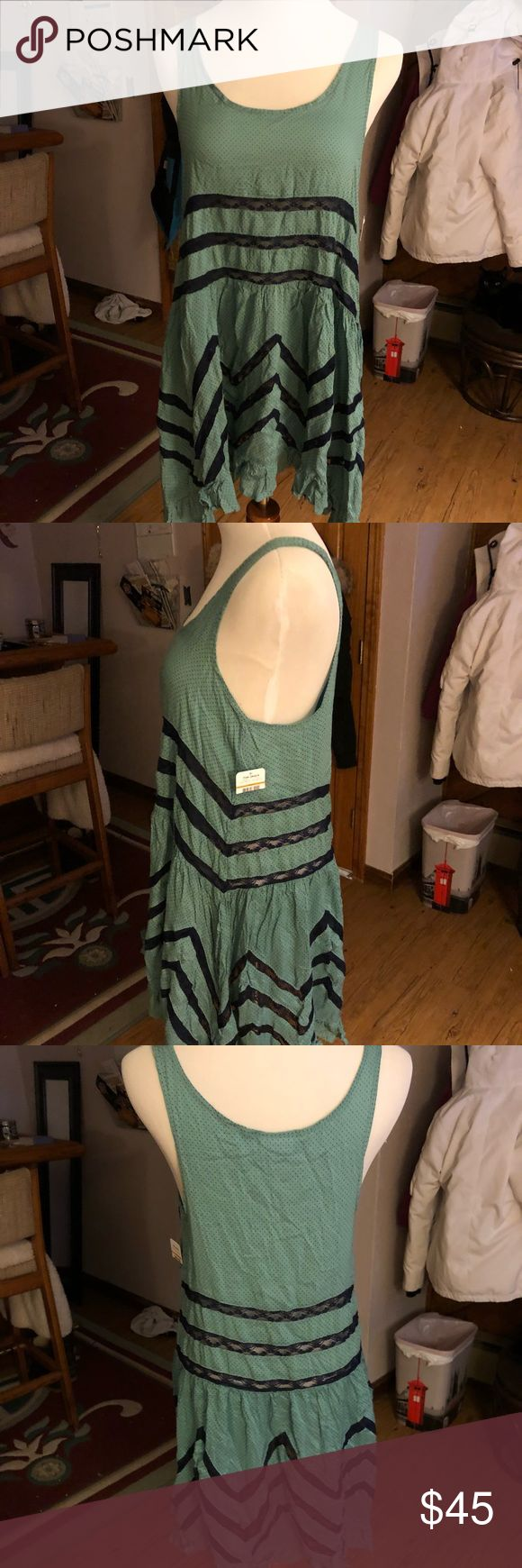 Free People • NWT Turquoise Blue Trapeze Slip NWT free people turquoise blue voile and lace trapeze slip size small. I discount bundles! Free People Dresses Asymmetrical