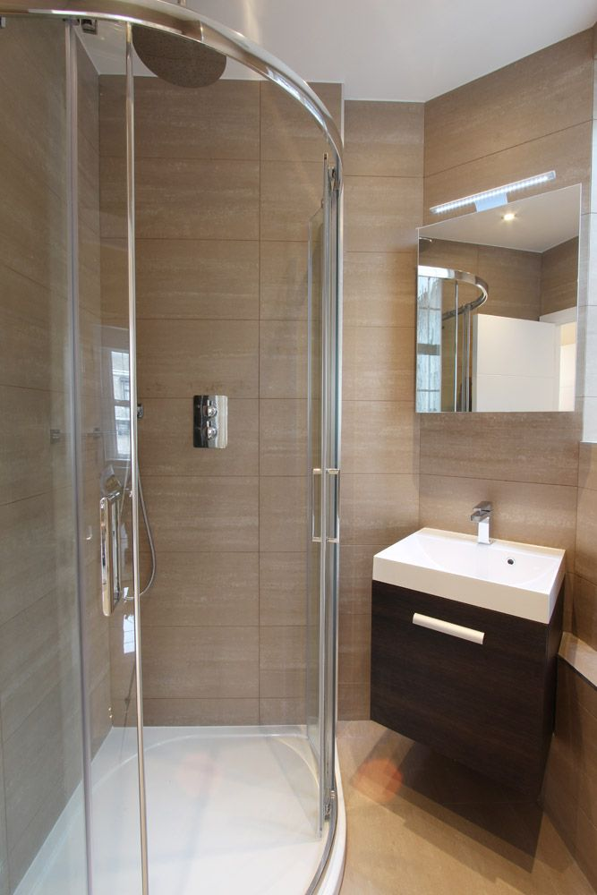 Compact ensuite bathroom with full sized shower and modern sink. Tiles from the Travertine 1 range.