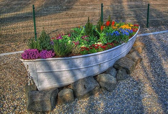 Old boat planter- I see a xc jump! And I just so happen to have a little canoe that would be PERFECT for something like this. Oh yes, this is gonna happen. :)