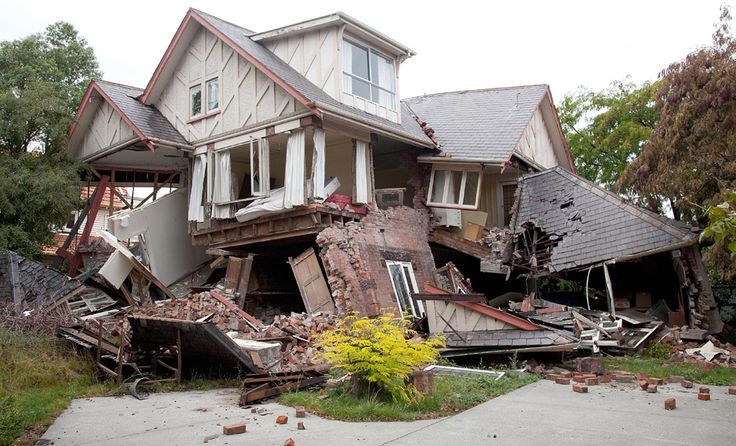 The remains of a destroyed house lies in ruins in Christchurch.