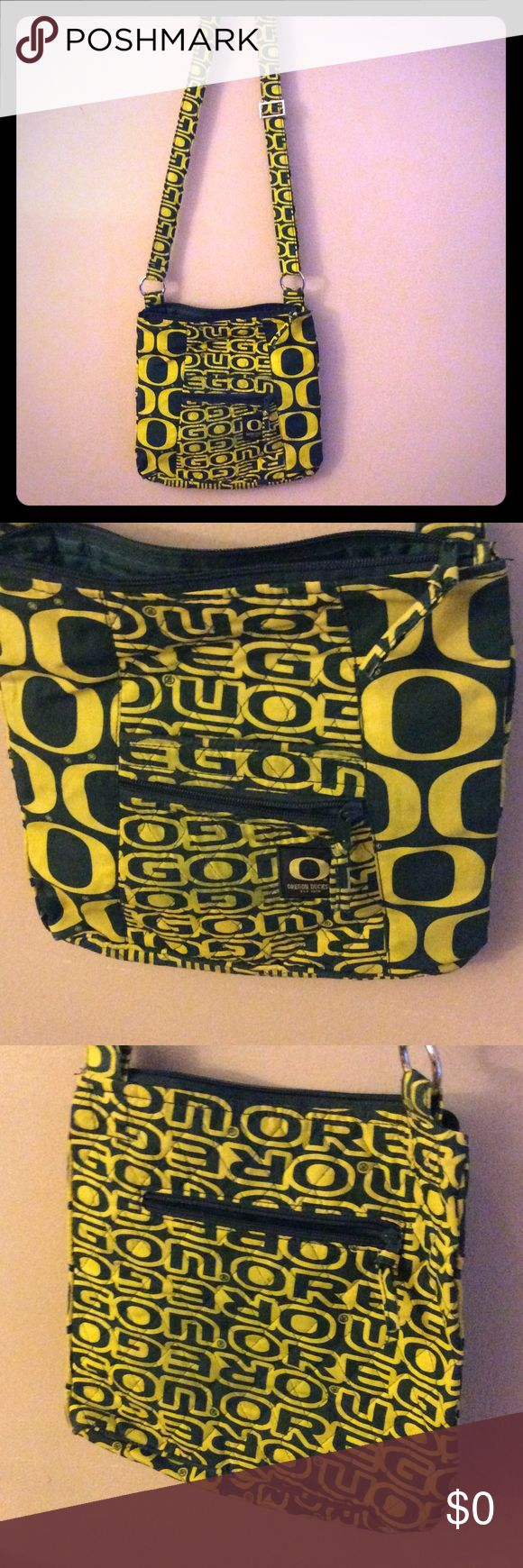Oregon Cloth Crossbody bag Game Day Oregon Ducks Crossbody bag. Zippers on front and back of the bag.  One interior pocket.  Adjustable strap. Forever Collectibles Bags Crossbody Bags