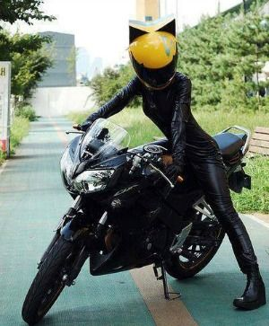 Female biker with cat ear motorcycle helmet