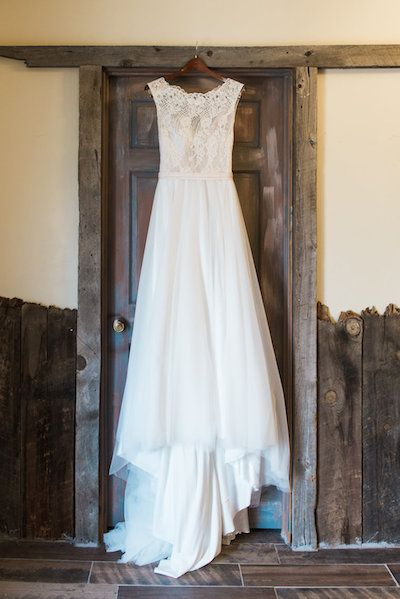 Rustic Colorado Barn Wedding: Lace wedding dress Catherine Hamilton Photography, Orchid Princess Floral, The Barn at Evergreen Memorial Park www.organicallyyouevents.com