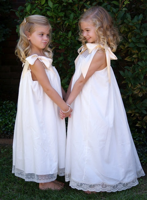 Flower Girls- Sisters- simple dresses with left over lace the pearl bracelets are an added touch of sweetness