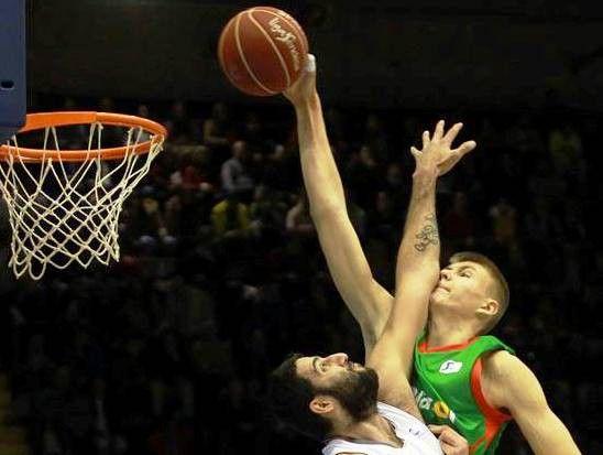 A young Kristaps Porzingis dunking on a random, Eastern-European, bearded guy.