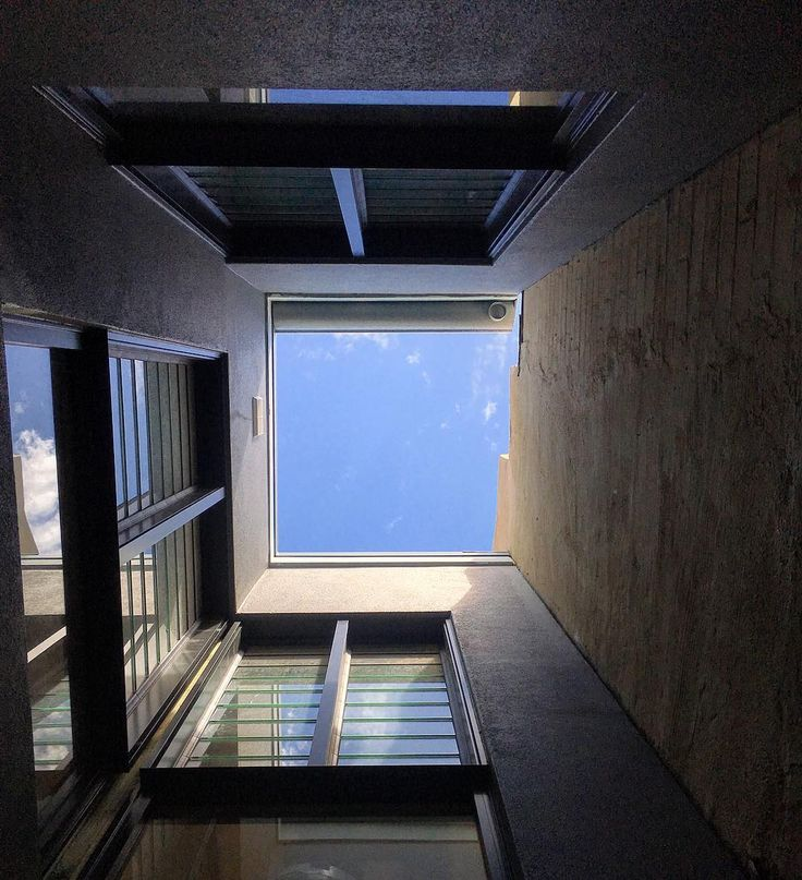 Double height internal courtyard adjoining the large stairwell void at the Woollhara Terrace. #residential #architecture #design #terrace #house #home #void #light #sydney #construction