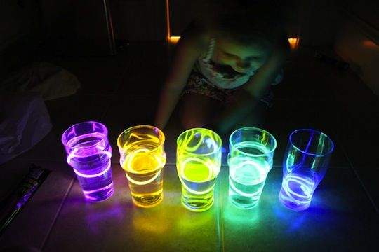 Glow bracelets in water glasses for a Glow-in-the-Dark water xylophone!