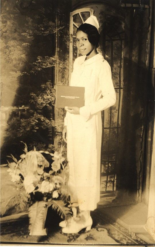 A nurse stands for portrait after earning her Diploma in Nursing (DIN) degree, United States, 1920s. Pictures of Nursing: The Zwerdling Postcard Collection. National Library of Medicine