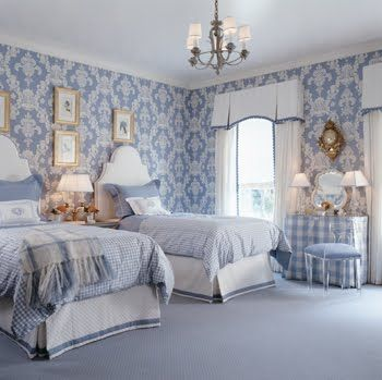 Blue and white bedroom with damask wallpaper, gingham bedding, white headboards, white curtains and bed skirts with blue trim and a girly va...