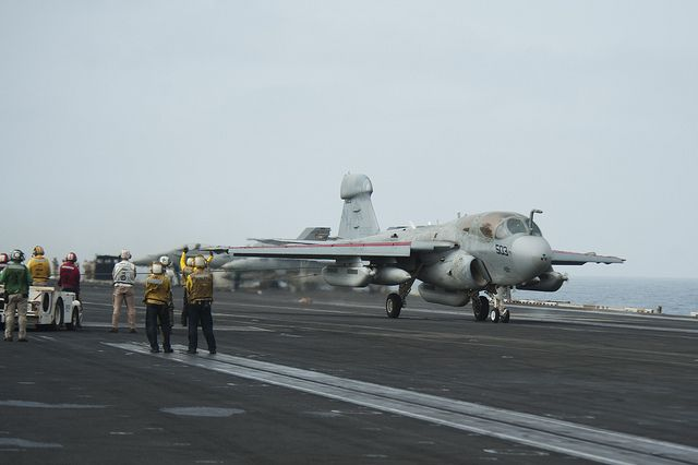 "NORTH ARABIAN SEA (July 19, 2013) An EA-6B Prowler assigned to the ""Gray Wolves"" of Electronic Attack Squadron (VAQ) 142 lands on the flight deck of the aircraft carrier USS Nimitz (CVN 68). Nimitz Strike Group is deployed to the U.S. 5th Fleet area of responsibility conducting maritime security operations, theater security cooperation efforts and support missions for Operation Enduring Freedom. (U.S. Navy photo by Mass Communication Specialist 3rd Class Raul Moreno Jr./Released)"