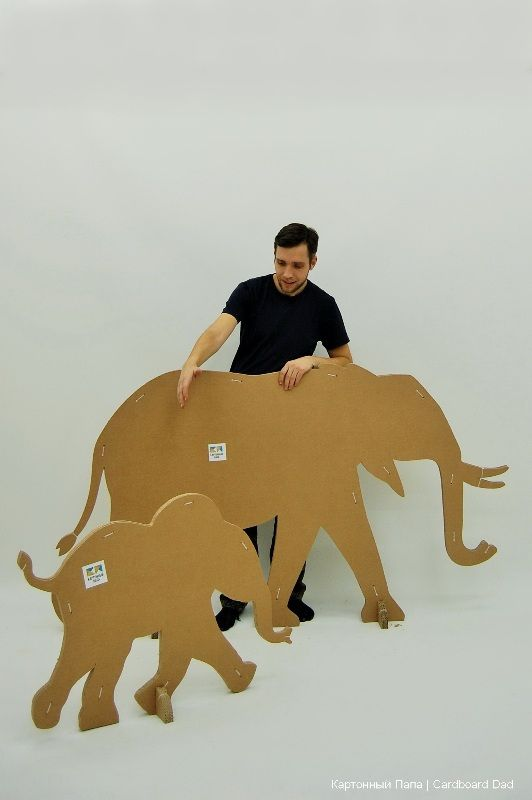 Cardboard animals.  Site is a foreign language, but notice how they animals are braced, so they don't have to be stuck to the wall.