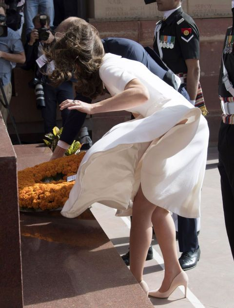 In her most painful wardrobe malfunction to date, Kate's cream dress flew up while she was placing a wreath at a war memorial in Delhi, India.  Haha , awesome !