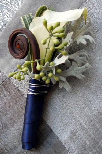 Calla lily with fiddlehead fern curl