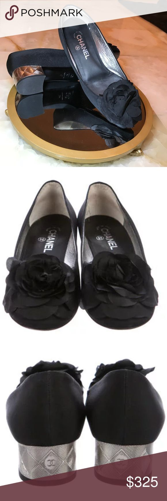 **Beautiful Chanel Pumps** From the Pre-Fall 2010 Collection. Black canvas Chanel pumps with tonal stitching, square toes, camellia accent at tops and mirrored textured at heels. Includes original dust bag.  Shoe says EU 40 but fits like a 9/9.5. CHANEL Shoes