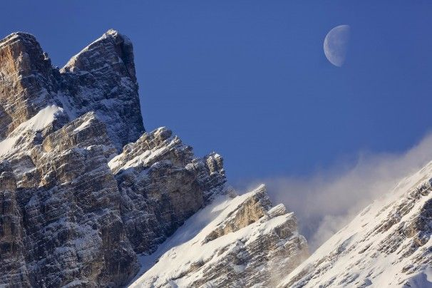 Jan. 23, 2014 The setting moon is framed by the crests of Mt. Pelmo in San Vito di Cadore, in the Italian Alps.