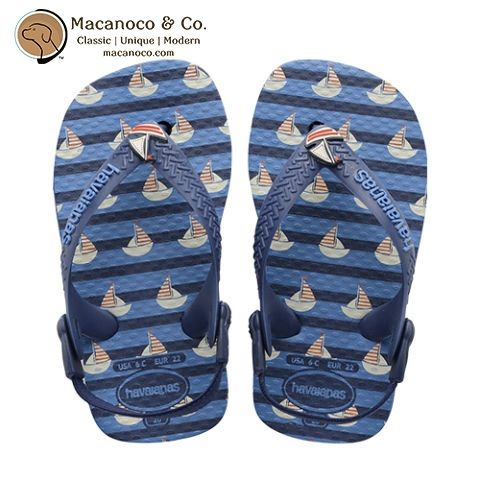 Your little one sets sail in the Baby Boat sandal.    Playful sailboats bob across the a striped sole and fabric slingback straps keep tiny feet comfortable and secure.    A sailboat embellishment on the strap completes the look.      	Thong style with a comfortable slingback strap for a secure fit  	Cushioned footbed with textured rice pattern and rubber sole  	Made in Brazil      Order at http://www.macanoco.com/shop/havaianas-baby-boat-sandal-navy-blue/ | Shop this product here…