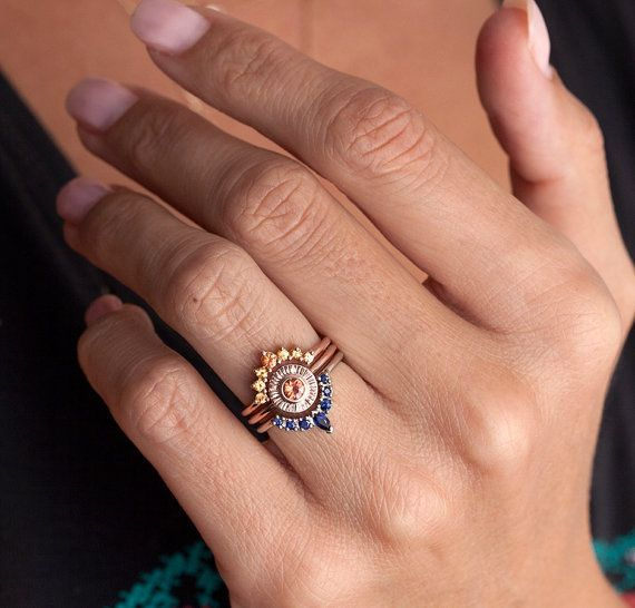 Sunset Ring Set Unique Wedding Ring Set Sapphire Ring by MinimalVS. My dream ring set- in rose gold with a pristine alexandrite center stone. Reminds me of YHI, the Australian Aboriginal Sun Goddess that I identify with.... I wonder if I could get one of the blue or yellow rings now, and then the center ring when A and I actually have a ceremony?