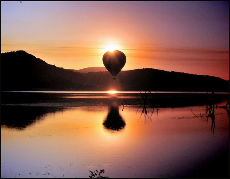 Mankwe Lake, Pilanesberg National Park, South Africa    Partial eclipse of the sun.