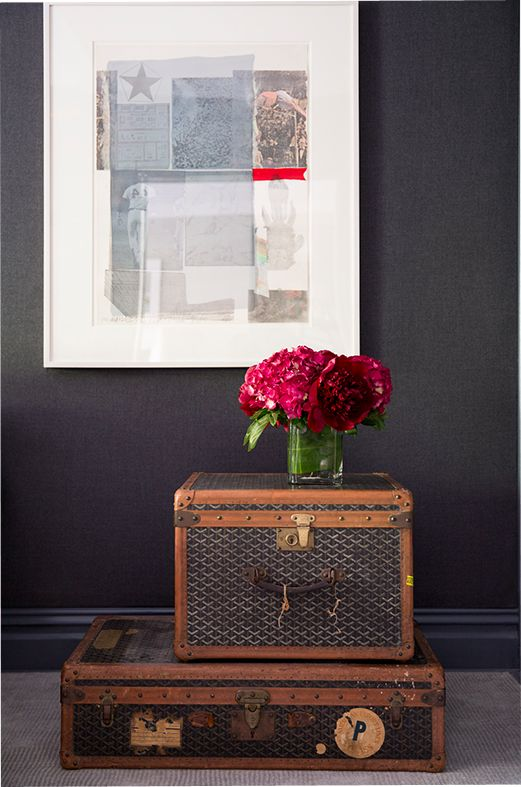 Vintage trunks serve as functional creative decor and storage. Just add some flowers or photos on top!