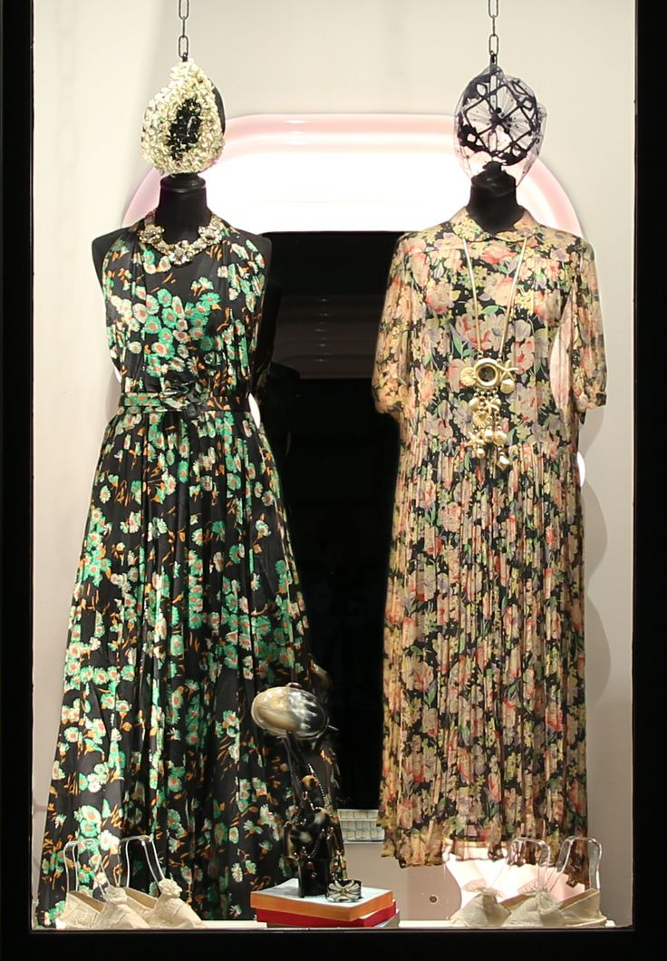 On the left wearing:1970s cotton floral dress, 1980s Cascio necklace, 1920s Italian floral hat.  Outfit on the right:1970s chiffon floral dress, 1970s couture necklace, 1950s pillbox hat.  On the pedestal:Our handmade Espadrille+Lace, bakelite clutch, 1980s Radà necklace, 1980s bakelite bracelet, our handmade Espadrille+Lace.