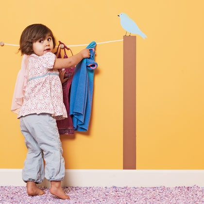 """So cute...little """"clothes line"""" painted on the wall with hooks."""