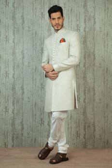 Jute linen nawabi sherwani embellished with kasab work. Item number M16-06 from #Benzer #Benzerworld #WeddingDressesForMen