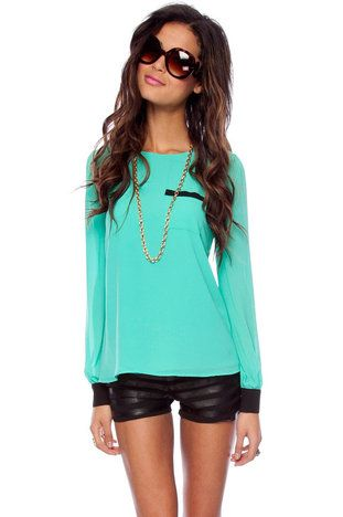 neon teal top also the leather shorts are a must have!