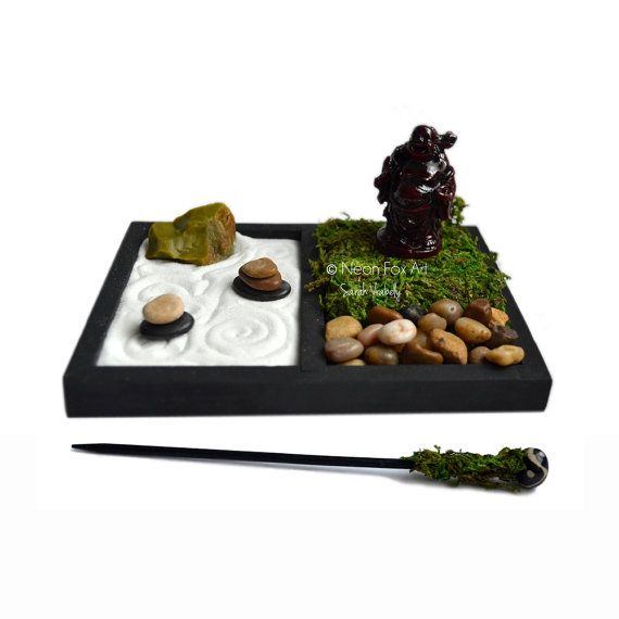 Handmade, miniature desktop zen garden featuring a mini Laughing Buddha statue! The miniature Buddha figurine sits to one side on a bed of moss with