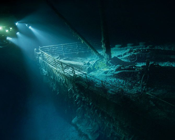 Photograph by Walden Media  More than two miles down, the ghostly bow of the Titanic emerges from the darkness on a dive by explorer and filmmaker James Cameron in 2001. The ship might have survived a head-on collision with an iceberg, but a sideswipe across her starboard side pierced too many of her watertight compartments.