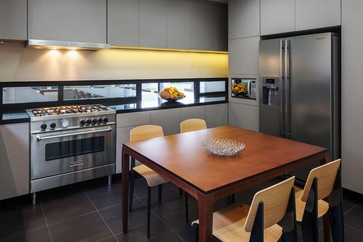 Architecture: Wooden Dining Table And Wooden Chairs Black Tile Flooring Kitchen Stove White Kitchen Cabinet Stainless Steel Refrigerator Kitchen: An Impressive Example of Contemporary Brazilian Architecture: Planalto Home